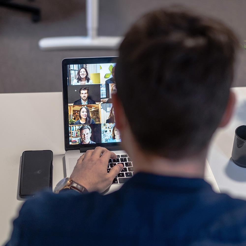 man on video call meeting