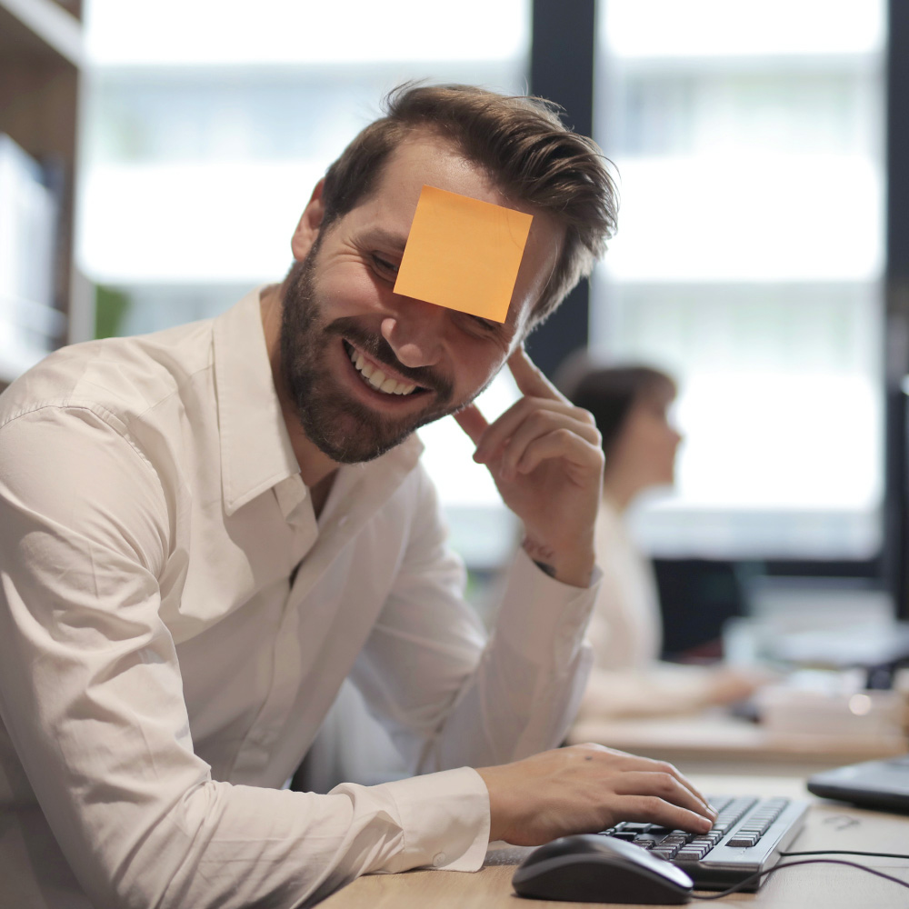 man with post it on forehead