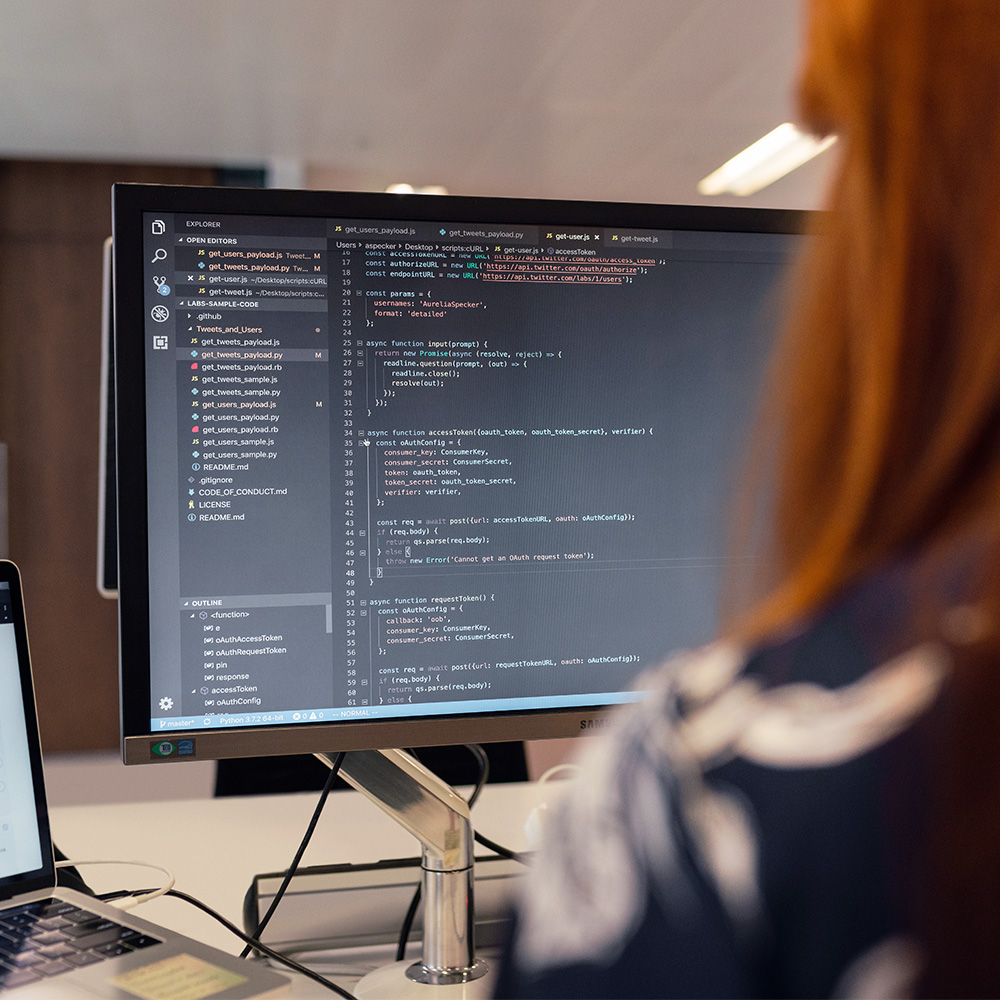 red haired woman coding
