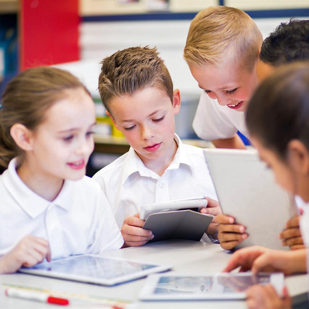 school-kids-learning-on-tablets
